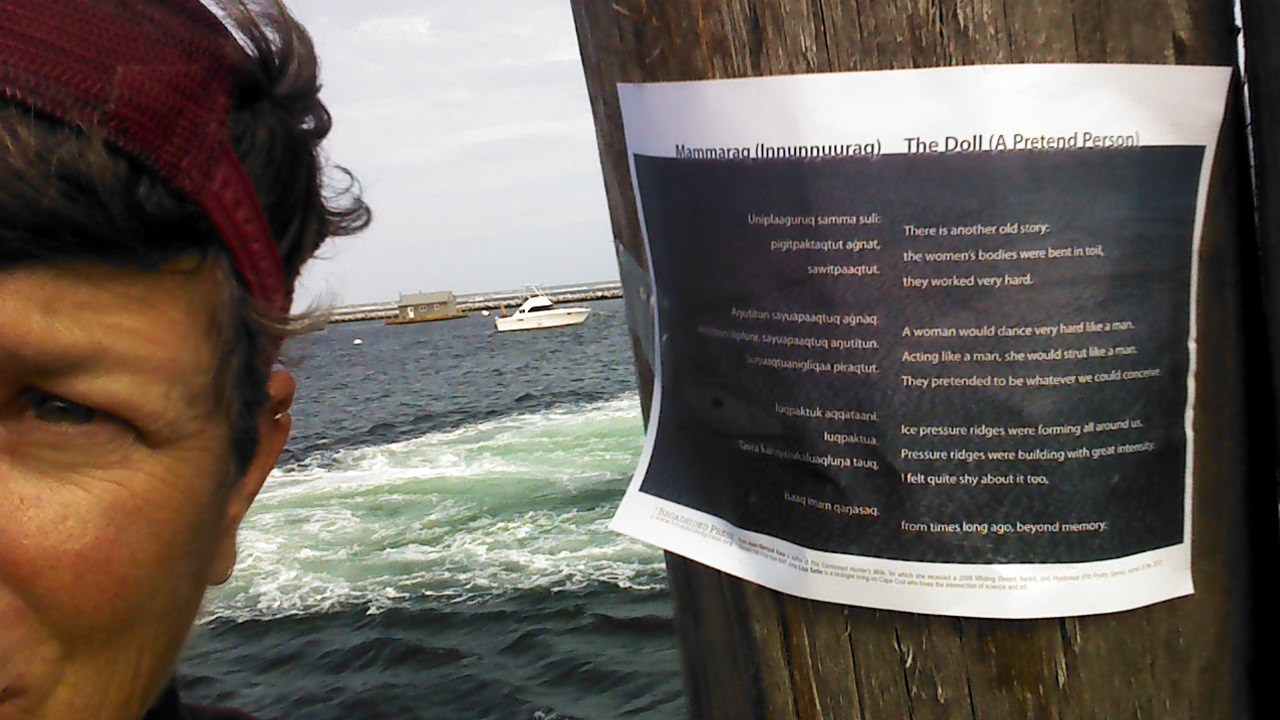 Half the artist's face is visible on the left, the broadside is taped to a wooden piling on the right.  In the middle/background: frothy sea and a boat at anchor.