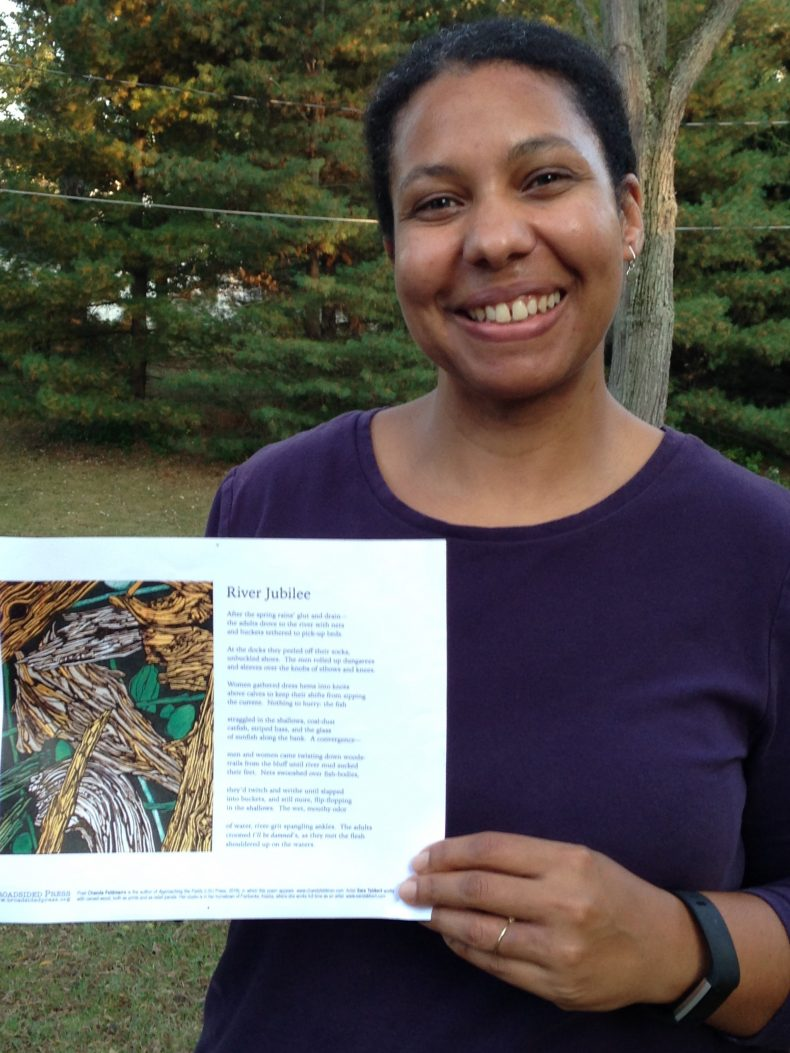 "Poet Chanda Feldman with her broadside, ""River Jubilee."""