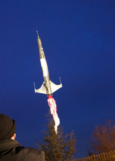 """Artist Se Thut Quon """"launches"""" the broadside on """"Round Baby"""" rocket."""
