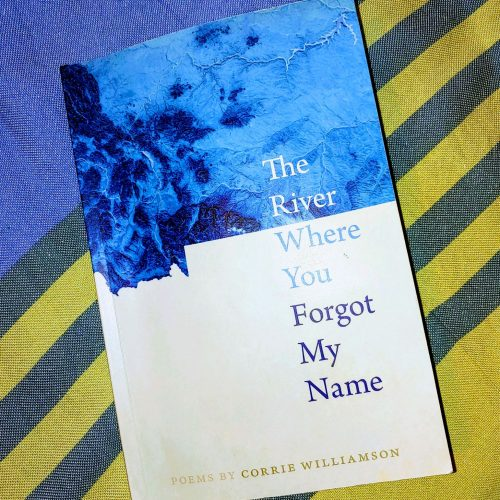 """The River Where You Forgot My Name"" laid on a striped blanket."