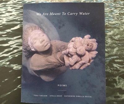 "Cover of ""We Were Meant to Carry Water"" which has an image of a terracotta sculpture of a woman, viewed from above, holding up an offering."